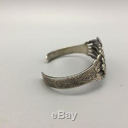 Fred Harvey Era Silver Bracelet With Snake Eye Turquoise Cuts in this Bracelet