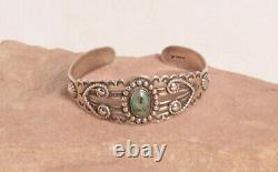 Fred Harvey Style Silver Navajo Bracelet with One Green Turquoise Stone c. 1920s